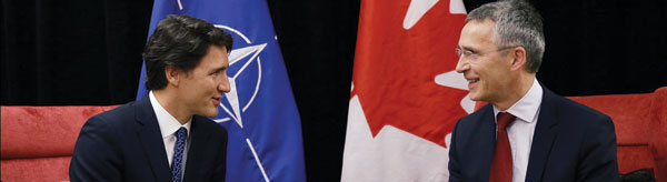 Canadian Prime Minister Justin Trudeau (left) meets with NATO Secretary General Jens Stoltenberg during the annual World Economic Forum 2016.