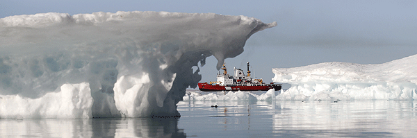 Canadian Coast Guard Ship (CCGS) Pierre Radisson sails past an iceberg in the Hudson Strait off the coast of Baffin Island during Operation Nanook.