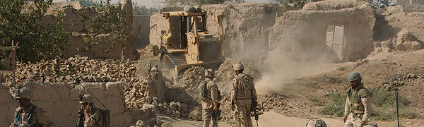Sept 2006 – A CAF engineer bulldozer clears away rubble in the Panjwaii District of Kandahar Province. Task Force Afghanistan was part of Canada's mission to help Afghans rebuild their lives and their nation by providing a secure environment in which to do so.