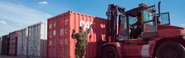 Oct 2015 – Cpl Michel Vaillancourt, a Traffic Technician from 5 Service Battalion directs the forklift driver as new supplies arrive in  Portugal to augment supplies for  Jointex as part of Exercise  Trident Juncture.