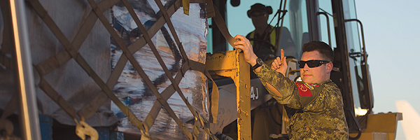 May 2016 – Cpl Karl Langer directs a load of emergency supplies to be transported by a CC-130J Hercules aircraft from Edmonton to Fort McMurray, as part of the Canadian Armed Forces' support to the Province  of Alberta's emergency response to devastating ­wildfires in the area.